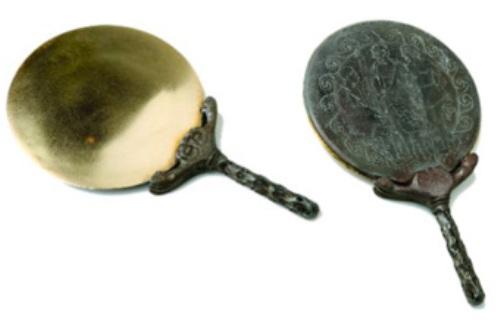 Espejo antiguo de bronce pulido