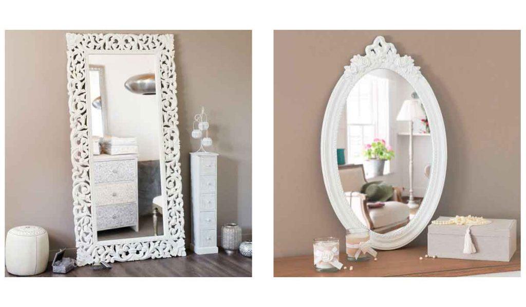 espejos blancos con marcos de madera